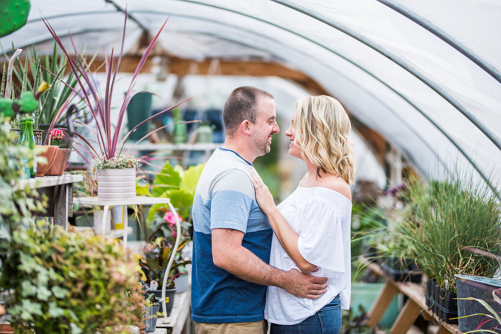 couple in greenhouse smiling Kaitlyn Ferris engaged