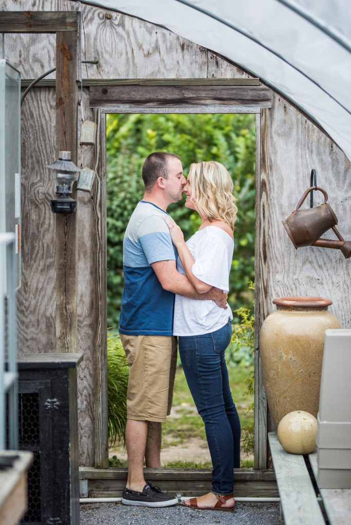 couple in greenhouse doorframe Kaitlyn Ferris engaged