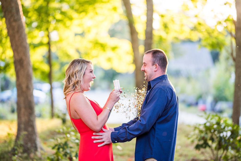 couple popping confetti Kaitlyn Ferris engaged