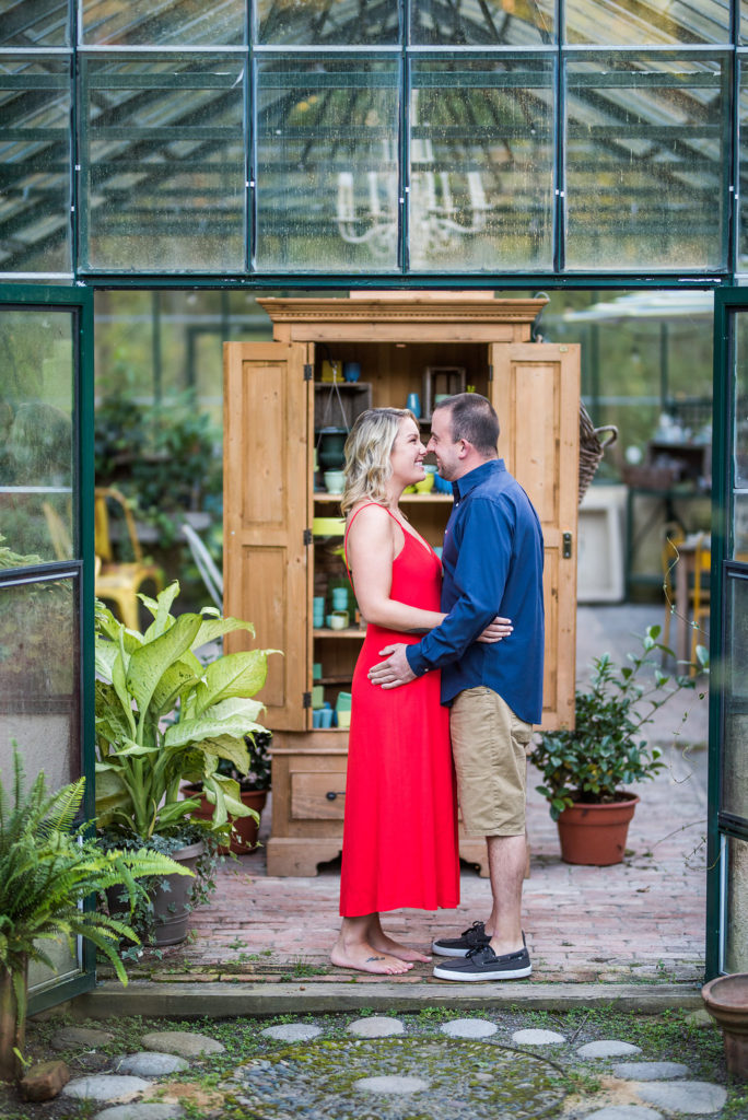 couple in greenhouse red dress Kaitlyn Ferris engaged