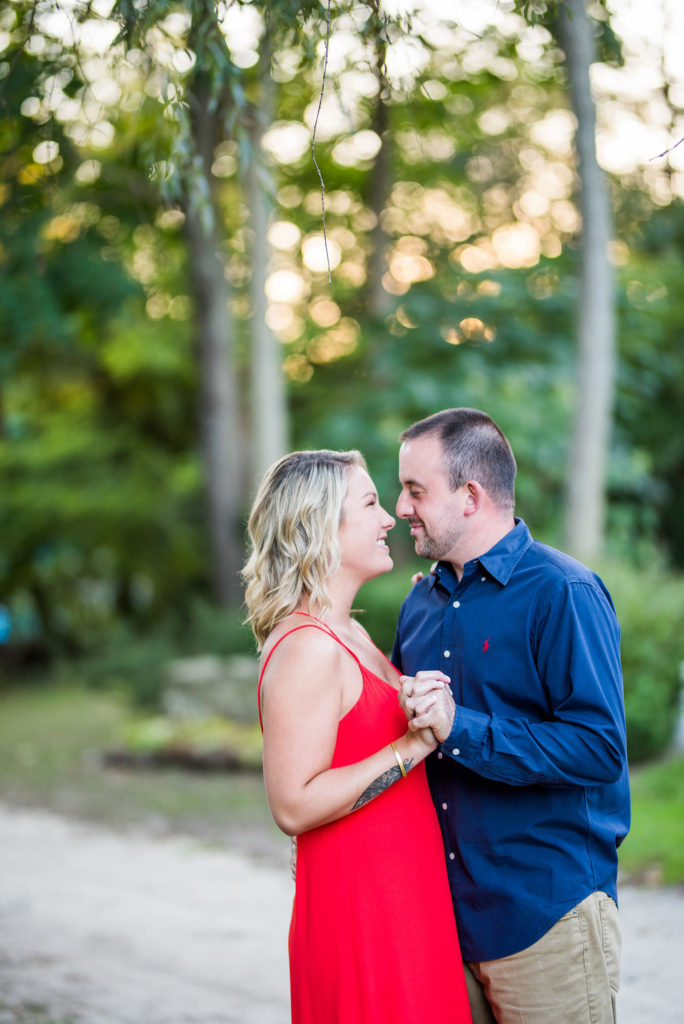 couple dancing in greenery Kaitlyn Ferris engaged