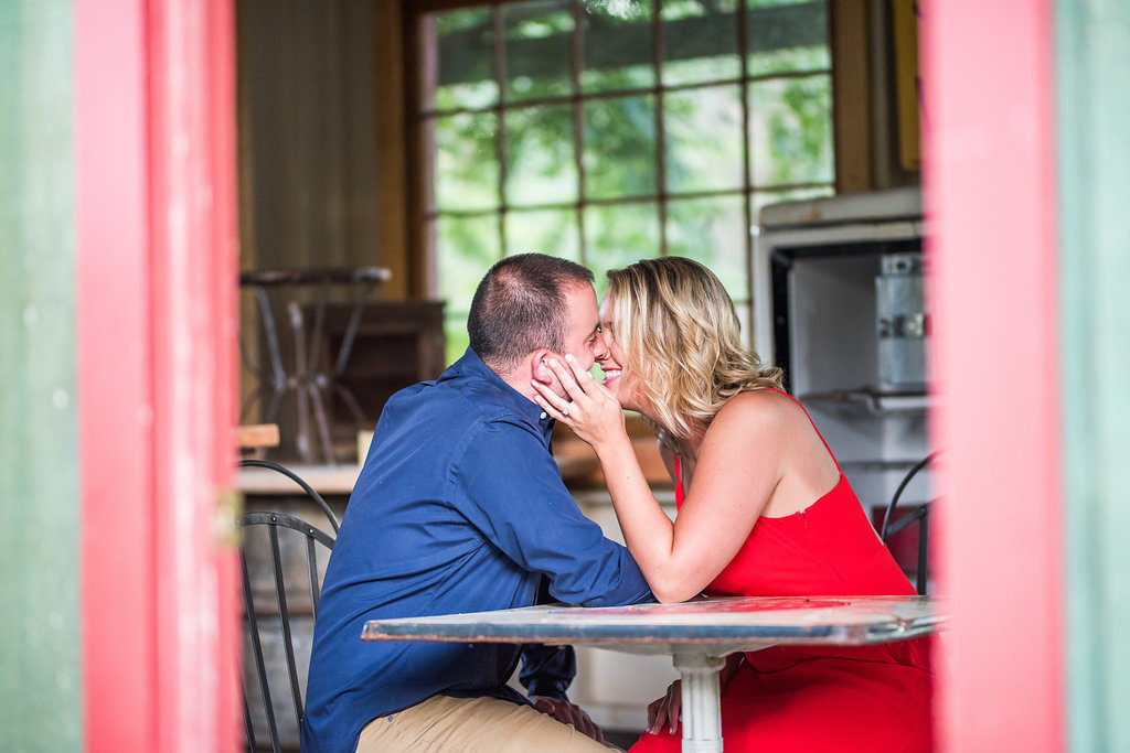 couple sitting in colorful room Kaitlyn Ferris engaged