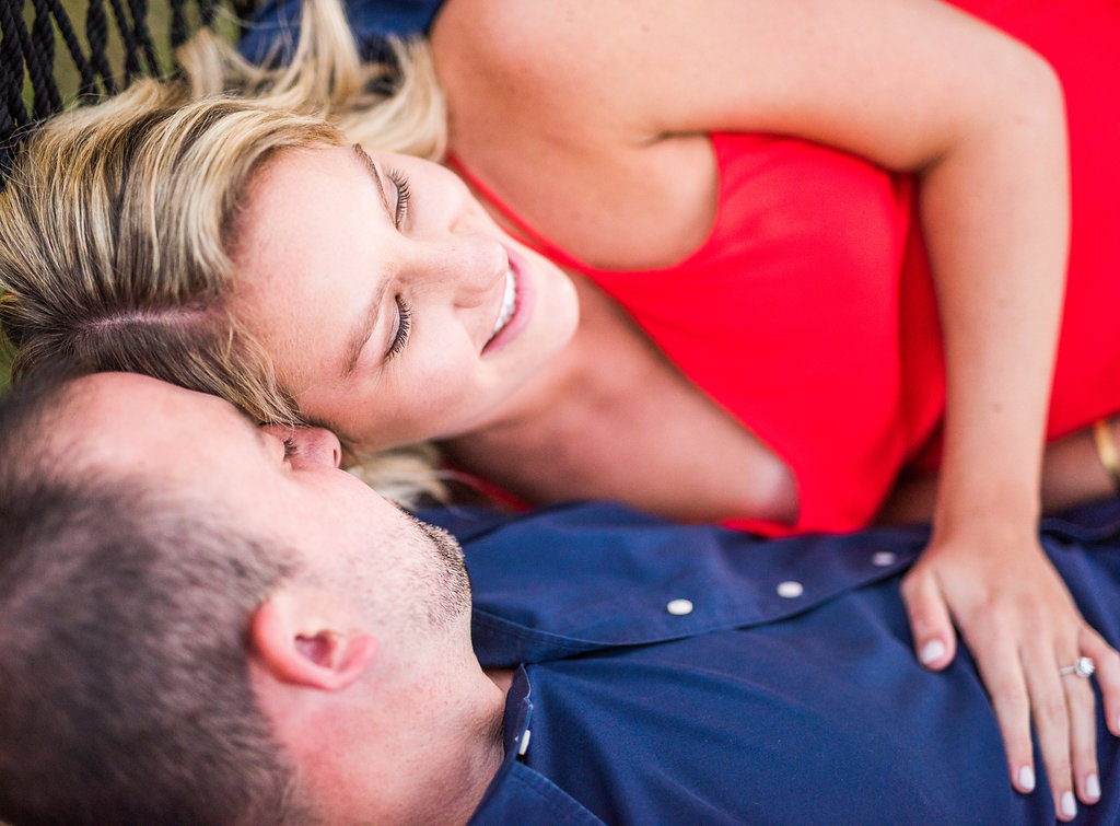 couple laying down red dress Kaitlyn Ferris engaged