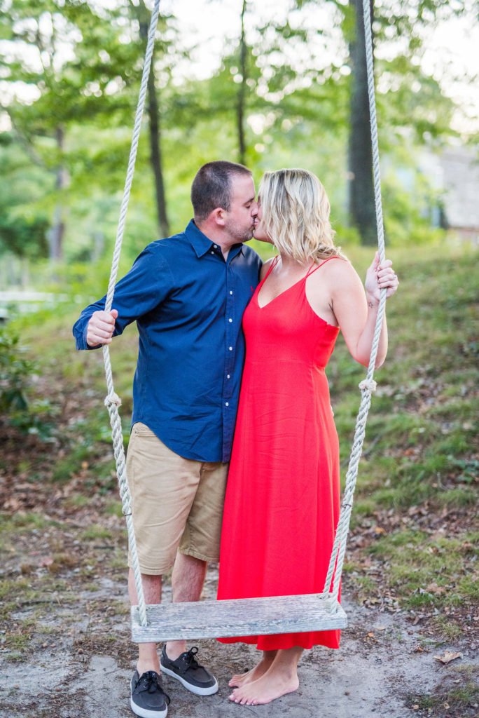 couple kissing on swing barefoot Kaitlyn Ferris engaged