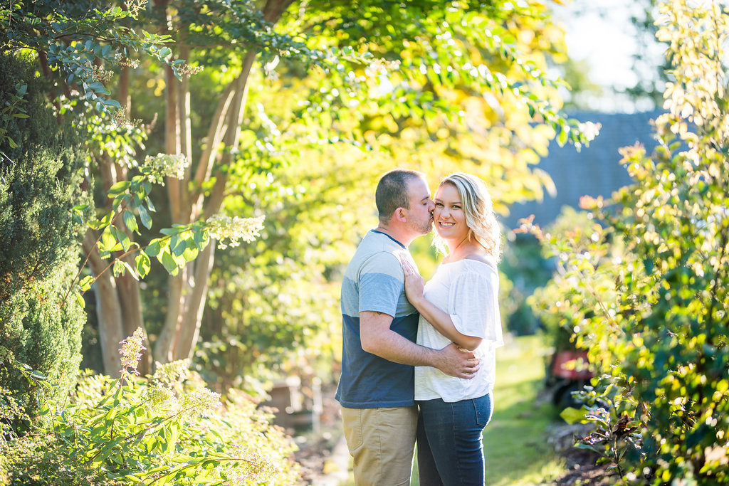 couple standing in greenery Kaitlyn Ferris engaged