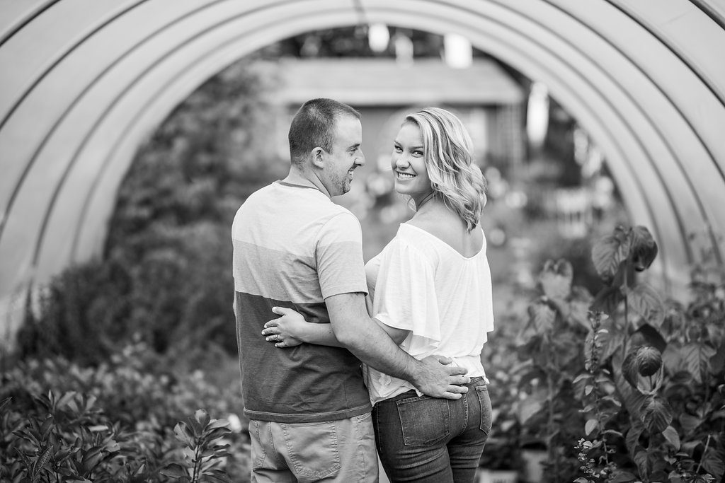 black and white couple in greenhouse Kaitlyn Ferris engaged