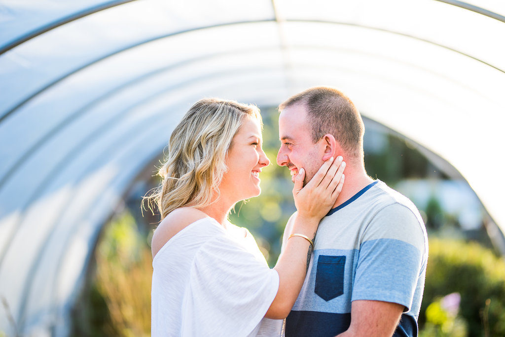 couple laughing in greenhouse Kaitlyn Ferris engaged