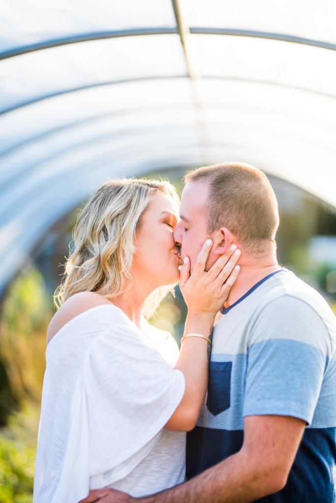couple kissing in greenhouse Kaitlyn Ferris engaged