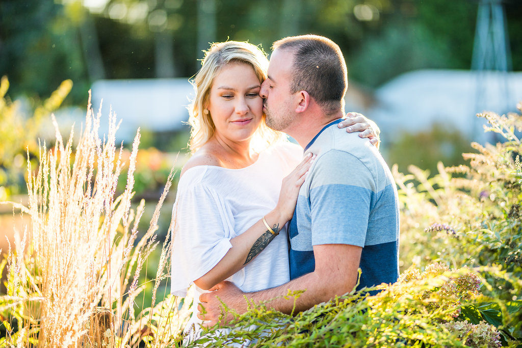 couple kissing in greenery Kaitlyn Ferris engaged