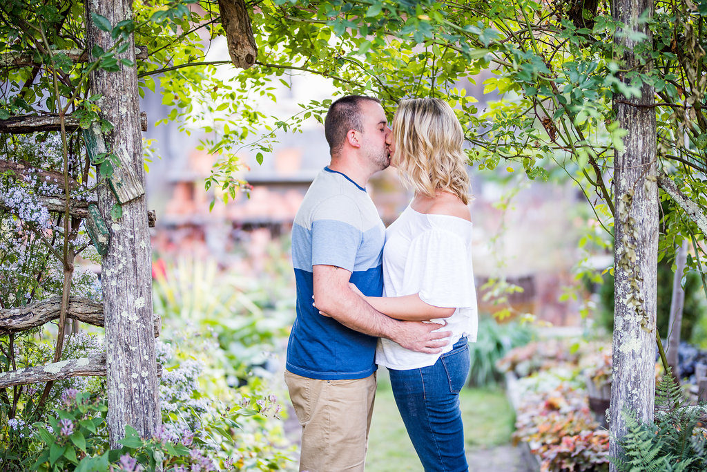 kissing under an arbor Kaitlyn Ferris engaged