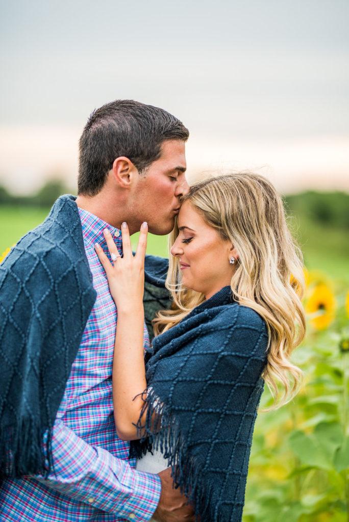 blue blanket sunflower field romantic engagement
