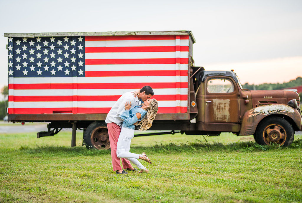 kiss American flag truck romantic engagement