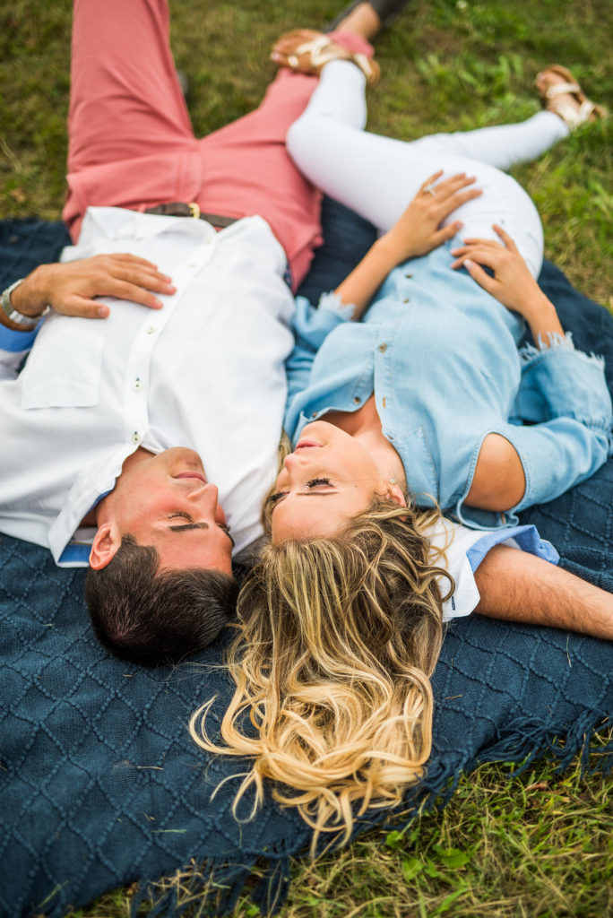 laying on a blanket romantic engagement