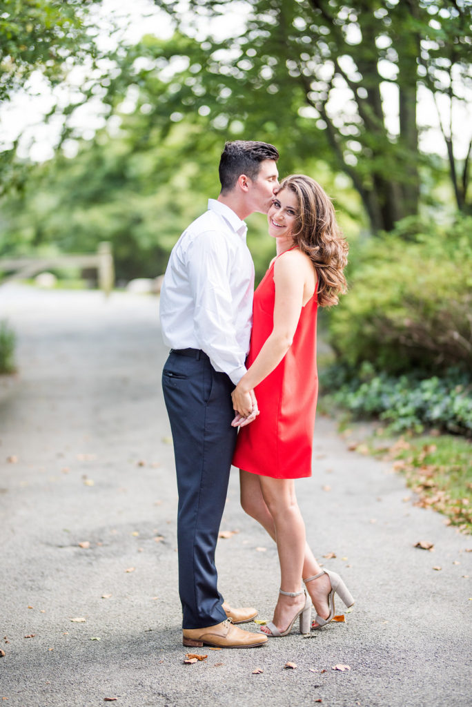 forehead kiss smile red dress summer engagement