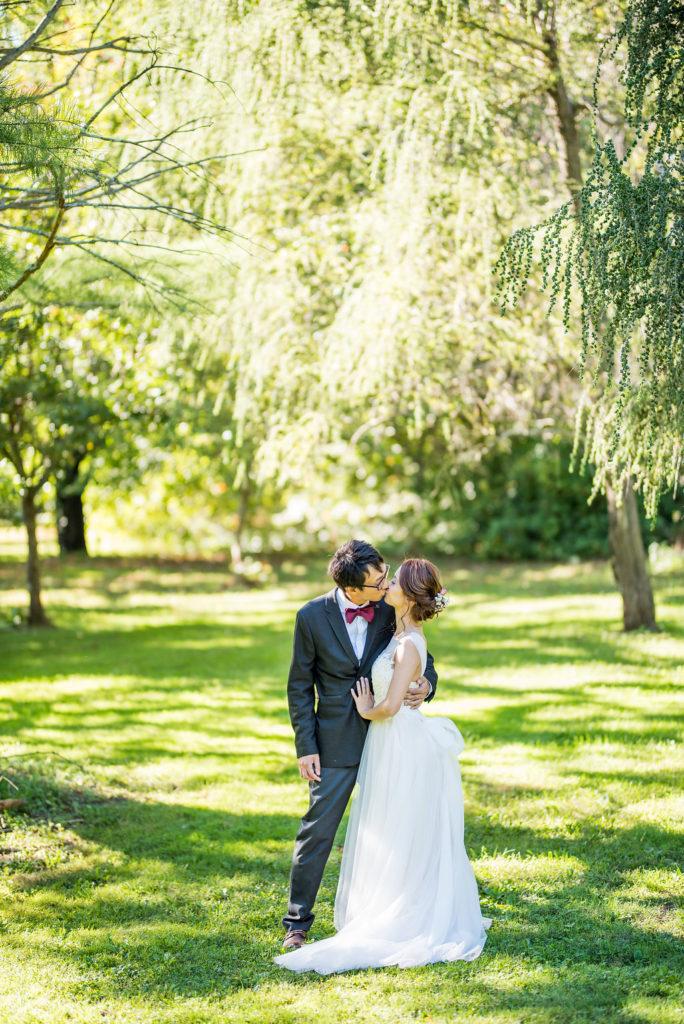 standing under a tree bride and groom Kaitlyn Ferris photography garden wedding