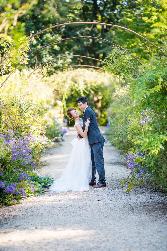 bride and groom laughing under metal arbor Kaitlyn Ferris photography garden wedding