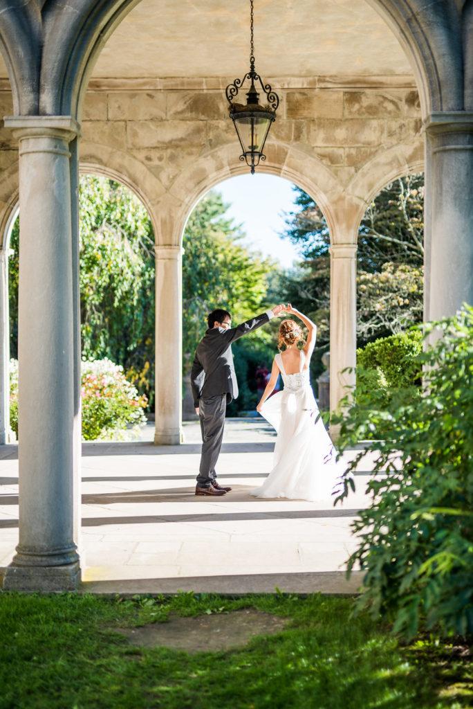 bride and groom twirling Kaitlyn Ferris photography garden wedding