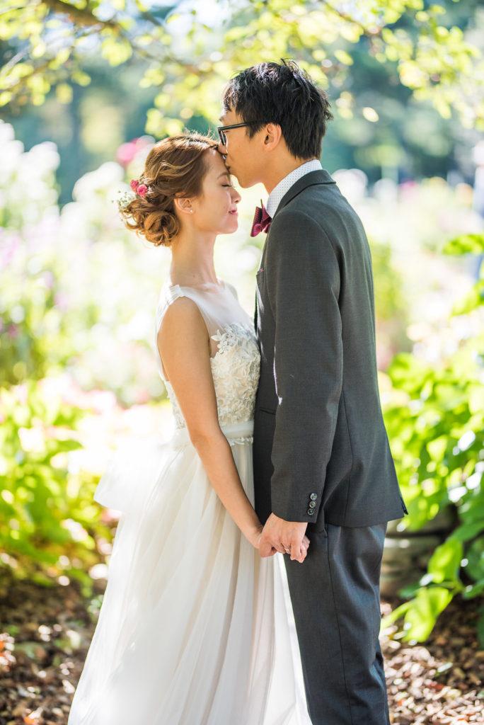 forehead kiss couple garden wedding