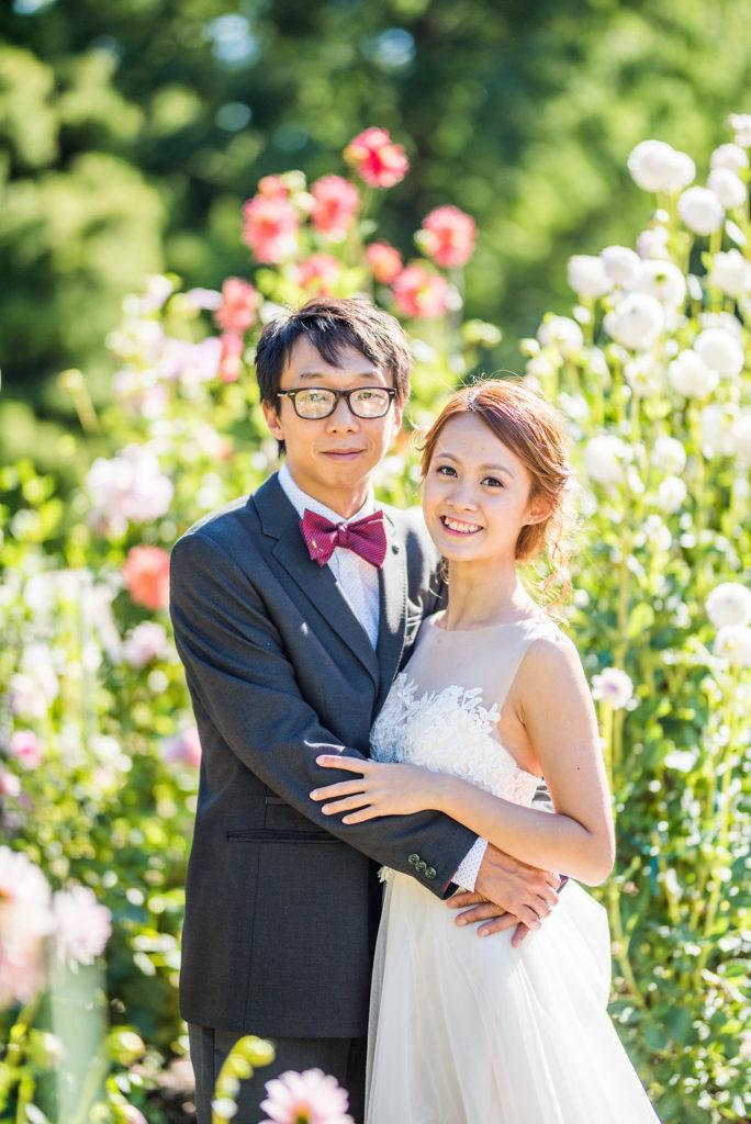 couple in front of flowers garden wedding