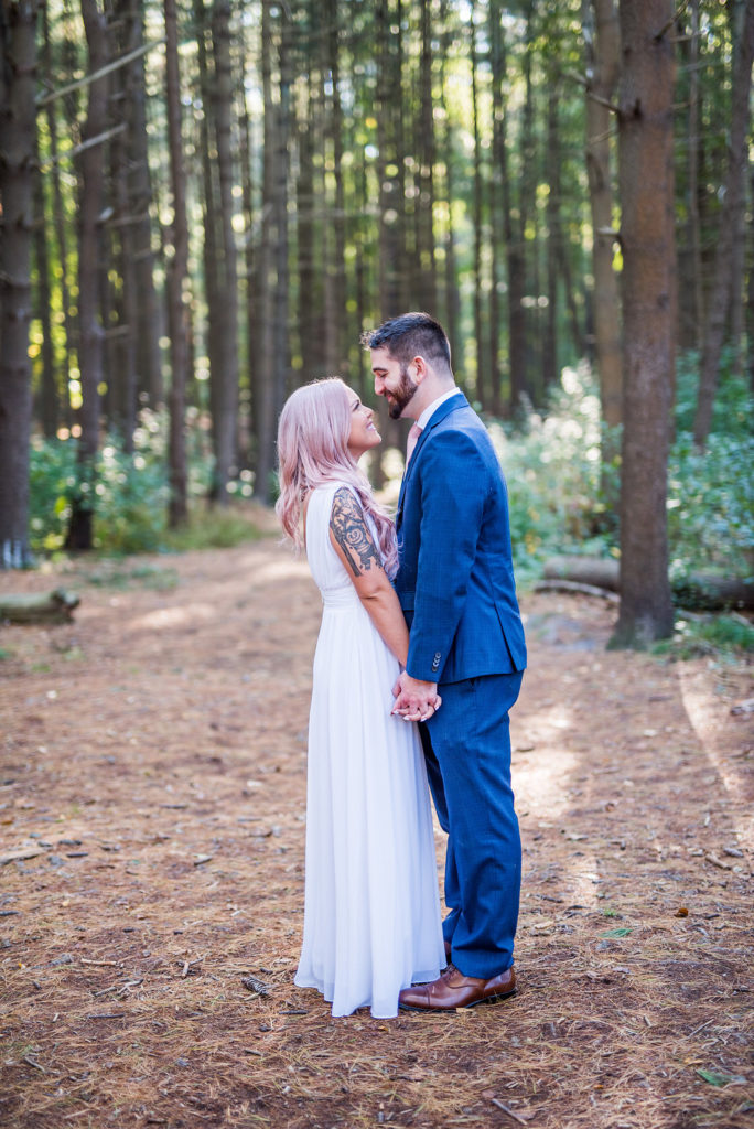 couple in woods Kaitlyn Ferris Photography Long Island Wedding Photographer